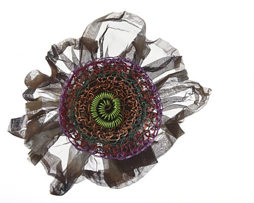 Rosette brooch made from stainless steel mesh, recycled television wire and bought wire. by Alison Bailey Smith